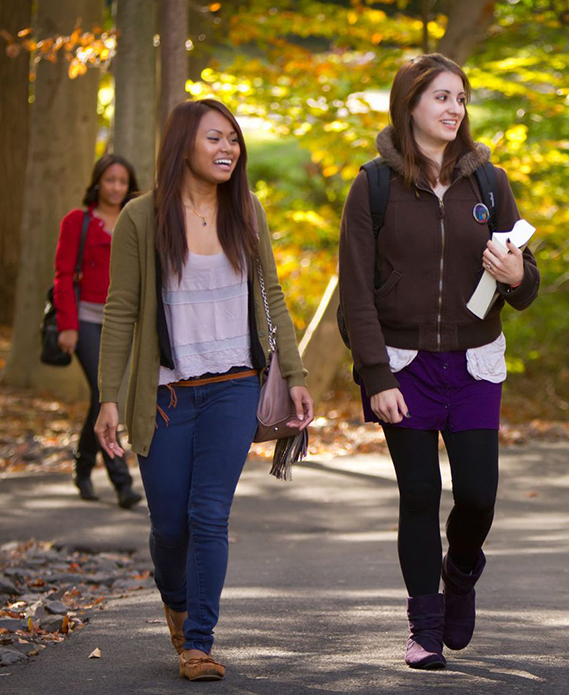 Penn State Division of Undergraduate Studies- students walking across campus in fall